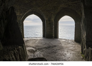 view from inside old building looking out to the sea and plymouth sound at penlee battery, cornwall, uk