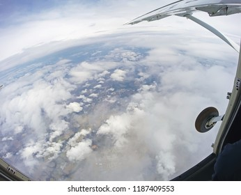 View from inside the parachute plane with the door open
