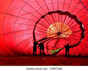 View of the inside of a red hot air balloon being inflated