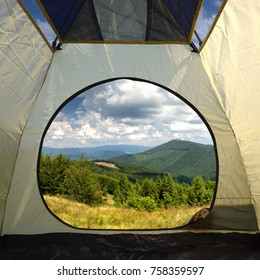 View from inside a tent on mountains landscape. Travel lifestyle concept adventure vacations outdoor