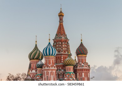 View of  Intercession Cathedral (St. Basil's) domes against blue sky at sunset in Red Square in Moscow, Russia.
