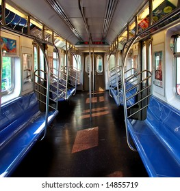 View of interior of a clean subway car starting its route.