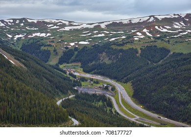View of Interstate 70, the Eisenhower Tunnel and mountains from Loveland Pass, located high in the mountains of Colorado