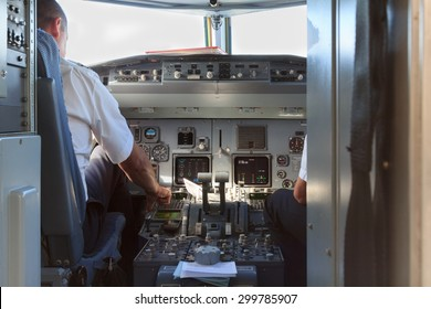 A view into a an airplane cockpit with pilots after landing