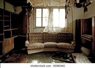 View into a burnt-out room with sofa