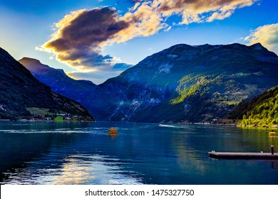 The view into the fjord at the beautiful city og Geiranger west in Norway.