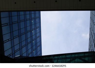 view into sky through a hole in scyscraper
