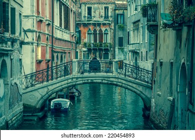 view into a small canal in Venice at night