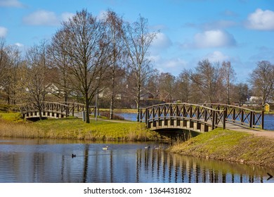 View into the small town park, in the small Swedish town Markaryd. Typical for the park are the two wooden bridges.