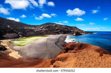 View into a volcanic crater with its green lake near El Golfo, Lanzarote island, Spain
