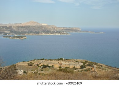 The view of Intzedin Fort, a former Greek political prison and execution site, and Souda Bay harbour to Akrtiri peninsula