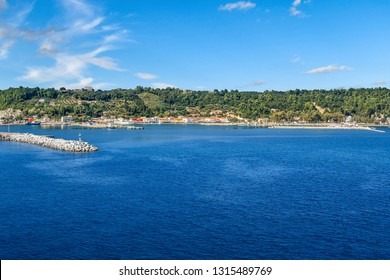 A view from the Ionian Sea of the Katakolon Olympia Greece coastal town, breakwater and cruise Port of Call on a sunny summer day