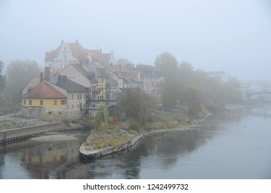 View from the Iron Bridge in Regensburg, Germany with Danube and historic buildings