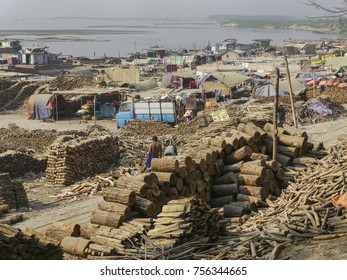 View of the Irrawaddy river bank in Mandalay. Wood market. Signs of deforestation