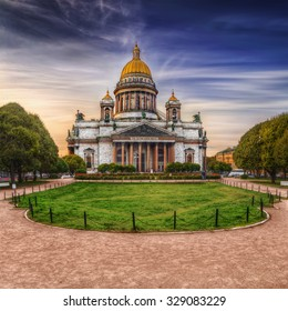 View of Isaac's Cathedral from park square in St. Petersburg (Russia).  Text (the quote from Matthew Gospel)  in Old Church Slavonic: Temple is my home, it's for praying.