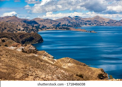 View from Isla del Sol, Titicaca Lake, Comunidad Challa, Bolivia. View of the Titicaca Lake on the border of Peru and Bolivia. Big blue lake in sunny weather with dramatic cloudy sky.