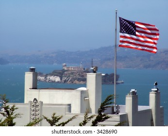 View of the island of Alcatraz from San Francisco, American flag