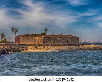 View of island Goree with fort and Dakar city visible in the background. Gorée Island. Dakar, Senegal. Africa. Île de Gorée.