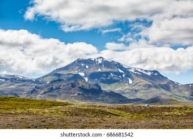 View of islandic mountains under cloudy sky