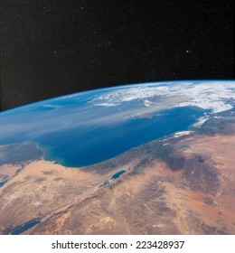 View of Israel, Jordan, Lebanon and Egypt from space with stars above.  Elements of this image furnished by NASA.