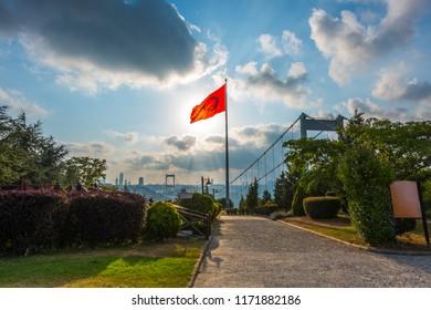 View of the Istanbul Bosphorus from Otagtepe. Fatih Sultan Mehmet Bridge with Turkish Flag. Istanbul, Turkey.