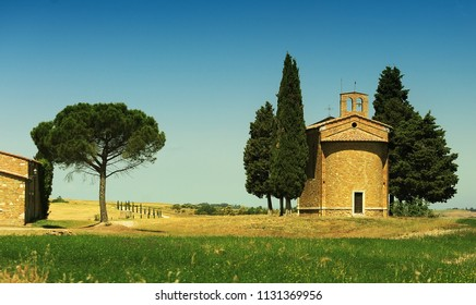 View of an Italian rural landscape with a chapel on a hill