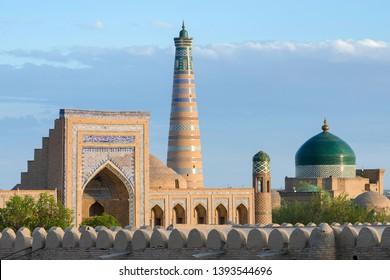 View at Itchan Kala (old or inner town), Mohammed Rakhim Khan Madrasah, Islam Khoja Minaret and Pakhlavan Makhmud Mausoleum. Khiva, Uzbekistan, Central Asia.