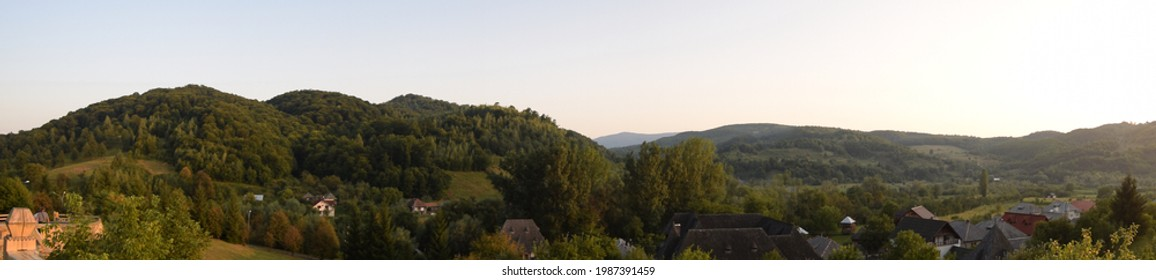 View of the Iza Valley from the historical Maramures, with landscapes in which the silence of the morning and the green in multiple shades of nature seem frozen from time immemorial