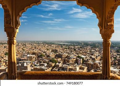 View of Jaisalmer city from Jaisalmer fort through arch. Jaisalmer, Rajasthan, India