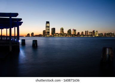 View of Jersey City from Battery park at sunset (Manhattan, New York)