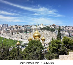 view of Jerusalem from the top of the Mount of Olives.Golden domes of the Church of Mary Magdalene, the old cemetery and the city wall