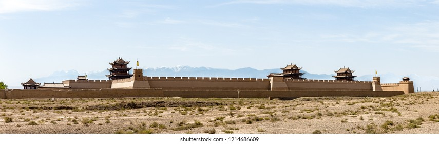 """View of Jiayuguan Fort with snow capped mountains on the background, Gansu, China. Known as """"first pass under the heaven"""", Jiayu Pass was the most western fort of ancient china on the silk road."""