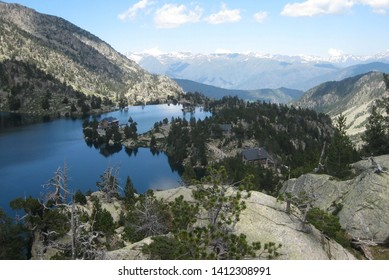 View with JM Blanc refuge on the lake Tort de Peguera, Aiguestortes i Estany de Sant Maurici National Park in Pyrenees, Spain