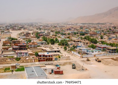 A view of Kabul Afghanistan with formalized settlements and hillsides