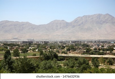 View of Kabul, Afghanistan taken from the Gardens of Babur during reconstruction of the gardens. Kabul city view with trees and mountains. View from the Gardens of Babur, Kabul, Afghanistan 2005.