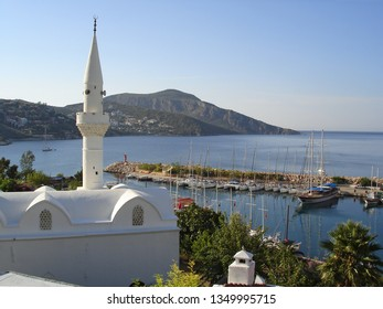 View of the Kalkan Marina with many yachts and boats. Kalkan is a small town on the Turkish Mediterranean coast and an famous tourist destination. Nice summer morning, view from a hotel terrace