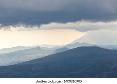 View of the Kamchatka mountains in overcast weather, Kamchatka Peninsula, Russia. Dramatic mount background