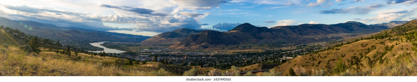 view of Kamloops In Beautiful British Columbia, Canada. overlooking the city from one of the many mountains. this city is know for its hiking, many lakes, biking trails, and multiple skii hills nearby