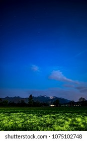 View to Kampenwand in Bavaria, Germany at night with stars