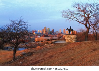 View of Kansas City, Missouri skyline at dusk during golden light from the Kansas City Scout Memorial with all registered trademarks removed.