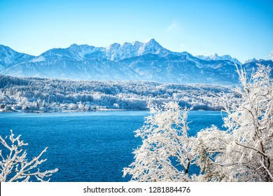 View of the Wörthersee and the Karawanken Mountains in the fresh snow in the Alps (Carinthia, Austria)