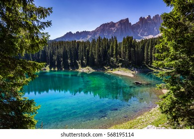 View of Karersee (Lago di Carezza), one of the most beautiful alpine lakes in the Italian Dolomites.
