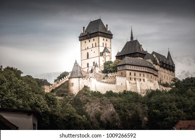 View of Karlstein Castle, a large Gothic castle founded in 1348 by King Charles IV. Karlstein village, Central Bohemia, Czech Republic.