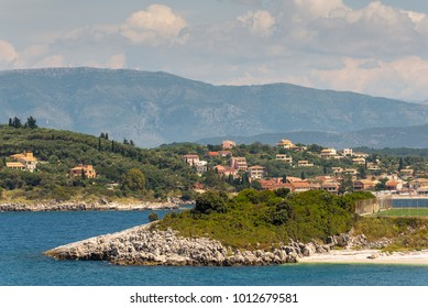 A view Kassiopi village with houses on the hills. North east coast of Corfu island, Greece