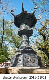 The view of Kasuga-doro bronze lantern in the garden of Yasukuni Shrine (Peaceful Country) in Chiyoda, Tokyo. Japan