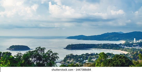 View of Kata Noi, Kata Yai and Karon Beaches from Karon Viewpoint. Famous Viewpoint in Phuket, Thailand. Picturesque top view to the tropical island with beach, blue sea, mountain, trees and resorts