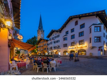 View of Katharinenkirche and cafe on Vorderstadt at dusk, Kitzbuhel, Austrian Tyrol Region, Austria, Europe 1-5-2019