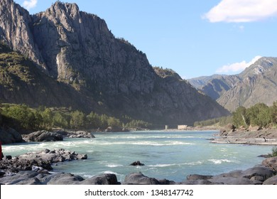 View of the Katun River. Altai Republic, Russia. Beautiful nature of the Altai Republic. Beautiful landscape with a turquoise river and the Altai Mountains