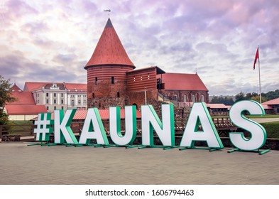 View of Kaunas castle and word Kaunas during sunset. Kaunas is tourist attraction city in south-central Lithuania. Kaunas Castle is a medieval fortress housing historical exhibitions.