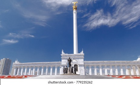 View of the Kazakh Eli Monument on Independence Square in Astana, the capital of Kazakhstan. Blue cloudy sky at summer day.